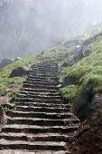 stock photo of step-up  - Stone steps going up into a mist  - JPG