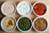 stock photo of tabouleh  - View looking down on six Arab or Turkish mezzes in  - JPG