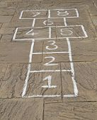 stock photo of hopscotch  - A Traditional HopScotch Game Marked Out on Slabs - JPG