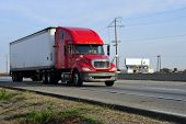 pic of big-rig  - Tractor trailer rig speeds down Highway 99 in California - JPG