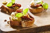 pic of tomato sandwich  - Italian cuisine appetizer bruschetta with tomatoes olives and cheese - JPG