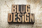 blog design word in vintage letterpress wood type on a grunge painted barn wood background