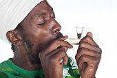 image of rastafari  - Rastafarian man smoking marihuana from a glass pipe - JPG