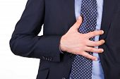 pic of gastritis  - Image of Business man suffering from heartburn - JPG