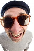 stock photo of honkers  - middle age senior man happy smiling wearing artist french hippie beret hat macro close up distorted large nose face - JPG