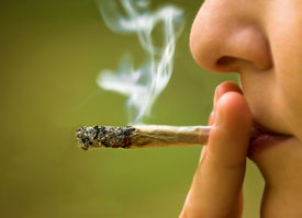 image of toxic substance  - girl smoking handmade cigarette marijuana close up  - JPG