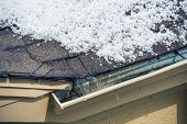stock photo of hail  - Small Melting Hail on the Roof - JPG