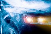 image of storms  - High Rain Car Driving Vehicle Headlights Closeup. Rain Storm. Transportation Concept.