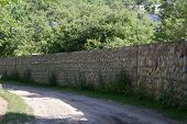 foto of bannister  - laid stone fence located along a country road - JPG