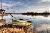 picture of shacks  - landscape at morning with abandoned boat and fishing shacks in the river of Ravenna Italy - JPG