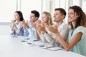 stock photo of half-dressed  - Casual business team clapping at presentation in the office - JPG