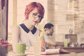 picture of teenagers  - Cute hipster teenage girl reading a book and enjoying coffee - JPG