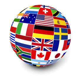 stock photo of globe  - Travel services and international business management concept with a globe and international flags of the world on white background - JPG