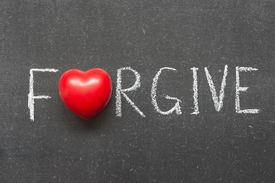 image of forgiveness  - forgive word handwritten on chalkboard with heart symbol instead of O - JPG
