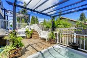 stock photo of pergola  - Walkout deck with jacuzzi and pergola - JPG
