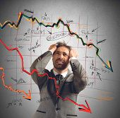 stock photo of collapse  - Businessman stressed out by the financial collapse - JPG