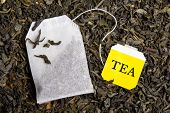 pic of tea bag  - background with dried black tea and paper tea bag - JPG