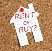 stock photo of house rent  - The question whether to Rent or Buy written on a paper reminder note in the shape of a house and pinned to a cork notice board - JPG