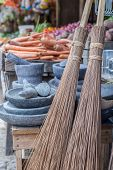 stock photo of broom  - Selective focus on group of old fashioned straw brooms for sell in asian market - JPG