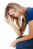 image of scratching head  - Portrait of depressed woman scratching her head - JPG