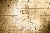 stock photo of hiv  - word hiv on wall with egyptian alphabet made in 2d software - JPG