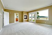 picture of master bedroom  - Empty master bedroom with walkout deck and fireplace - JPG