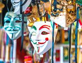 stock photo of venice carnival  - Venetian masks in store display in Venice - JPG