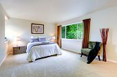 stock photo of master bedroom  - Bright master bedroom interior with brown curtains - JPG
