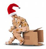 stock photo of thinking outside box  - Think outside the box concept on a white background with a Christmas hat - JPG