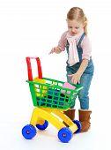 image of montessori school  - Girl puts shopping cart - JPG