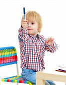 image of montessori school  - Little boy draws felt - JPG
