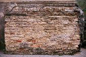 picture of pilaster  - fragment of brick pilaster with crumbling plaster - JPG