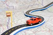 stock photo of gasoline station  - toy car on roadmap showing petrol station - JPG