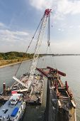pic of girder  - Floating crane carrying girder platform to support a bridge deconstruction on Rhine river Germany - JPG
