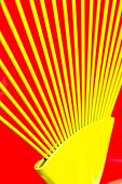 picture of iron star  - Yellow bars of iron rays on red background - JPG