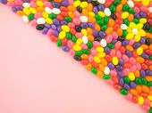 foto of jelly beans  - Frame and background made of colorful jelly beans - JPG