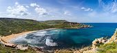image of gozo  - the rugged coastline of the island of Gozo are reflected in a blue sea - JPG