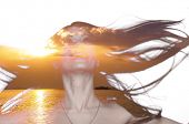 pic of flutter  - Double exposure photo of a young woman with fluttering hair and sunset over sea - JPG