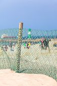 pic of sandstorms  - Beach life at a sunny day with a protection fence against sandstorm - JPG
