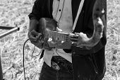 picture of hillbilly  - Thailand traditional musician hillbilly playing country folk music in rice paddy field black and white - JPG