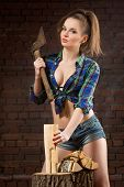foto of  boobs  - sexy girl in shirt chopping wood with an ax old - JPG