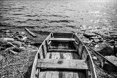 picture of old boat  - Old wooden fishing boat on lake coast in Karelia - JPG