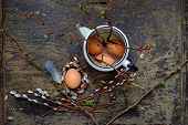 stock photo of willow  - Willow branches with egg on an old vintage wood from willow - JPG