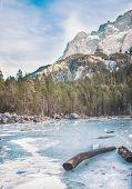 image of bavarian alps  - Frozen forest lake in Bavarian Alps near Eibsee lake in winter with mountains at the backdrop - JPG