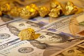 picture of gold nugget  - nugget gold and dollar bills - JPG