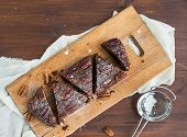 picture of pecan  - Pecan brownie cake on a wooden board - JPG