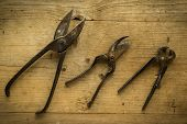 foto of pliers  - old vintage retro used scissors and pliers on wooden table - JPG