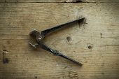 image of pliers  - old vintage retro used pliers on wooden table - JPG