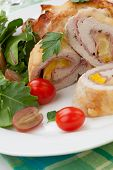 stock photo of kale  - Tasty chicken prosciutto roulade stuffed with cheese and pineapple served with baby kale grapes and cherry tomatoes salad - JPG