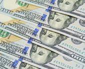 stock photo of one hundred dollar bill  - One hundred dollars pile as background - JPG